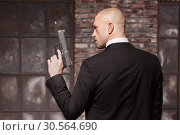 Contract murderer wallpaper or background concept. Стоковое фото, фотограф Tryapitsyn Sergiy / Фотобанк Лори