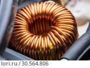Купить «Electric transformer copper coil closeup», фото № 30564806, снято 24 января 2017 г. (c) Tryapitsyn Sergiy / Фотобанк Лори