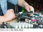 Service engineer work with computer motherboard. Стоковое фото, фотограф Tryapitsyn Sergiy / Фотобанк Лори