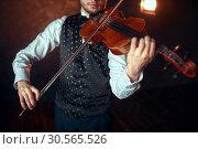 Купить «Male fiddler playing classical music on violin», фото № 30565526, снято 4 марта 2017 г. (c) Tryapitsyn Sergiy / Фотобанк Лори