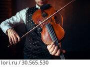 Купить «Male violinist playing classical music on violin», фото № 30565530, снято 4 марта 2017 г. (c) Tryapitsyn Sergiy / Фотобанк Лори