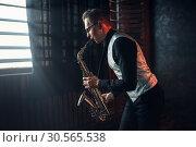 Купить «Saxophonist playing jazz melody on saxophone», фото № 30565538, снято 4 марта 2017 г. (c) Tryapitsyn Sergiy / Фотобанк Лори