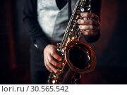 Купить «Jazz man hands holding saxophone closeup», фото № 30565542, снято 4 марта 2017 г. (c) Tryapitsyn Sergiy / Фотобанк Лори