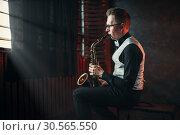 Купить «Saxophonist playing jazz melody on saxophone», фото № 30565550, снято 4 марта 2017 г. (c) Tryapitsyn Sergiy / Фотобанк Лори
