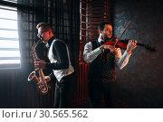 Купить «Sax man and fiddler duet playing classical melody», фото № 30565562, снято 4 марта 2017 г. (c) Tryapitsyn Sergiy / Фотобанк Лори