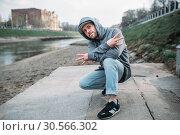 Male rapper posing on the street, urban dancing. Стоковое фото, фотограф Tryapitsyn Sergiy / Фотобанк Лори
