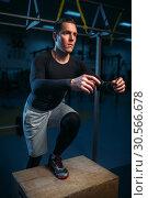 Athlete on training, endurance exercise with box. Стоковое фото, фотограф Tryapitsyn Sergiy / Фотобанк Лори