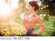 Pin up girl holds cardboard cup with a straw. Стоковое фото, фотограф Tryapitsyn Sergiy / Фотобанк Лори