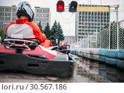 Купить «Go kart driver on start line, back view», фото № 30567186, снято 15 июня 2017 г. (c) Tryapitsyn Sergiy / Фотобанк Лори