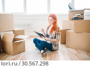 Купить «Woman sitting on the floor among cardboard boxes», фото № 30567298, снято 29 июня 2017 г. (c) Tryapitsyn Sergiy / Фотобанк Лори