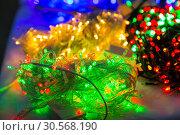 Christmas decoration closeup, lights, xmas garland. Стоковое фото, фотограф Tryapitsyn Sergiy / Фотобанк Лори
