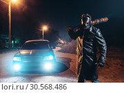 Купить «Maniac with bloody baseball bat against black car», фото № 30568486, снято 22 сентября 2017 г. (c) Tryapitsyn Sergiy / Фотобанк Лори