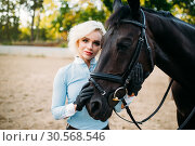 Portrait of woman and horse, horseback riding. Стоковое фото, фотограф Tryapitsyn Sergiy / Фотобанк Лори