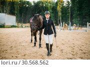 Купить «Equestrian sport, female jockey and horse», фото № 30568562, снято 17 сентября 2017 г. (c) Tryapitsyn Sergiy / Фотобанк Лори
