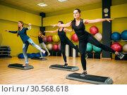 Women group on step aerobic training. Стоковое фото, фотограф Tryapitsyn Sergiy / Фотобанк Лори