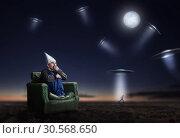 Stupid man in tinfoil helmet at night, UFO phobia. Стоковое фото, фотограф Tryapitsyn Sergiy / Фотобанк Лори