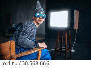 Man in tinfoil helmet and hypnotizing glasses, UFO. Стоковое фото, фотограф Tryapitsyn Sergiy / Фотобанк Лори