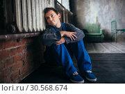 Купить «Depressed man sitting on the floor, psycho patient», фото № 30568674, снято 1 октября 2017 г. (c) Tryapitsyn Sergiy / Фотобанк Лори