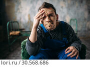 Купить «Madman, mouth sealed with plaster, psycho patient», фото № 30568686, снято 1 октября 2017 г. (c) Tryapitsyn Sergiy / Фотобанк Лори