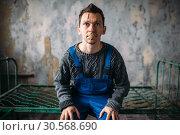 Купить «Madman, mouth sealed with plaster, psycho patient», фото № 30568690, снято 1 октября 2017 г. (c) Tryapitsyn Sergiy / Фотобанк Лори