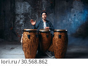 Drummer playing on wooden bongo drums, beat music. Стоковое фото, фотограф Tryapitsyn Sergiy / Фотобанк Лори