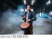 Купить «Male drummer playing on wooden drum», фото № 30568870, снято 26 октября 2017 г. (c) Tryapitsyn Sergiy / Фотобанк Лори