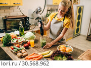 Купить «Female person cooking, mixing healthy organic food», фото № 30568962, снято 1 ноября 2017 г. (c) Tryapitsyn Sergiy / Фотобанк Лори