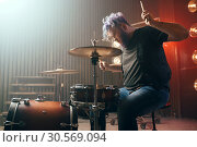 Купить «Bearded drummer with colorful hair on the stage», фото № 30569094, снято 10 ноября 2017 г. (c) Tryapitsyn Sergiy / Фотобанк Лори