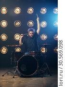 Купить «Bearded drummer with colorful hair on the stage», фото № 30569098, снято 10 ноября 2017 г. (c) Tryapitsyn Sergiy / Фотобанк Лори
