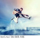 Купить «Rock guitarist with bas-guitar, snapshot in a jump», фото № 30569106, снято 10 ноября 2017 г. (c) Tryapitsyn Sergiy / Фотобанк Лори