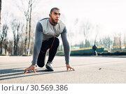 Купить «Jogger before running, active, healthy lifestyle», фото № 30569386, снято 28 ноября 2017 г. (c) Tryapitsyn Sergiy / Фотобанк Лори