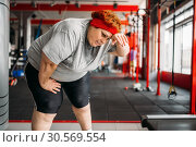 Tired fat woman after active training in gym. Стоковое фото, фотограф Tryapitsyn Sergiy / Фотобанк Лори