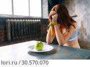 Купить «Womans hands are tied with measuring tape», фото № 30570070, снято 10 января 2018 г. (c) Tryapitsyn Sergiy / Фотобанк Лори