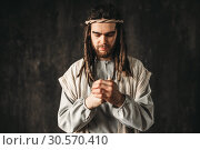 Man in the image of Jesus Christ praying. Стоковое фото, фотограф Tryapitsyn Sergiy / Фотобанк Лори