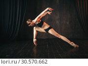 Classical ballet dancer in black practice training. Стоковое фото, фотограф Tryapitsyn Sergiy / Фотобанк Лори