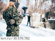 Купить «Female paintball player shooting at the enemy», фото № 30570782, снято 25 февраля 2018 г. (c) Tryapitsyn Sergiy / Фотобанк Лори