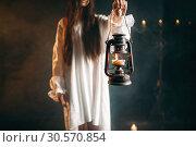 Female person holds kerosene lamp, dark magic. Стоковое фото, фотограф Tryapitsyn Sergiy / Фотобанк Лори