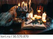 Купить «Witchcraft, dark magic, candles with ritual book», фото № 30570870, снято 27 февраля 2018 г. (c) Tryapitsyn Sergiy / Фотобанк Лори