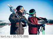 Купить «Skiers with skis and poles, extreme lifestyle», фото № 30570886, снято 6 марта 2018 г. (c) Tryapitsyn Sergiy / Фотобанк Лори