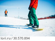 Купить «Snowboarder riding a snow hill, extreme sport», фото № 30570894, снято 6 марта 2018 г. (c) Tryapitsyn Sergiy / Фотобанк Лори
