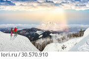 Купить «Downhill skiing, skiers on the top of slope», фото № 30570910, снято 27 мая 2020 г. (c) Tryapitsyn Sergiy / Фотобанк Лори