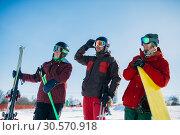 Купить «Skiers and snowboarder poses, winter sport», фото № 30570918, снято 6 марта 2018 г. (c) Tryapitsyn Sergiy / Фотобанк Лори