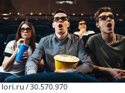 Surprised people in 3d glasses watching movie. Стоковое фото, фотограф Tryapitsyn Sergiy / Фотобанк Лори