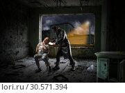 Купить «Murderer with meat cleaver trying to kill victim», фото № 30571394, снято 19 апреля 2018 г. (c) Tryapitsyn Sergiy / Фотобанк Лори