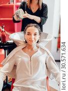 Купить «Hairdresser and customer, hair coloring process», фото № 30571634, снято 29 апреля 2018 г. (c) Tryapitsyn Sergiy / Фотобанк Лори