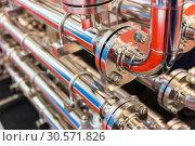 Купить «Steel water pipeline, metal fittings, closeup», фото № 30571826, снято 16 мая 2018 г. (c) Tryapitsyn Sergiy / Фотобанк Лори