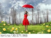 Купить «Woman in red dress with umbrella in dry forest», фото № 30571966, снято 24 мая 2018 г. (c) Tryapitsyn Sergiy / Фотобанк Лори