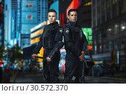 Купить «Cops with gun and a baton on guard of law», фото № 30572370, снято 6 июня 2018 г. (c) Tryapitsyn Sergiy / Фотобанк Лори