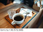 Купить «Cup of fresh black coffee, milk and glass of water», фото № 30572686, снято 24 июня 2018 г. (c) Tryapitsyn Sergiy / Фотобанк Лори