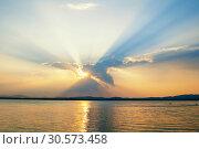 Купить «Sea landscape - sea water lit by sunset summer light. Sea summer nature with mountain range and colorful clouds», фото № 30573458, снято 16 августа 2013 г. (c) Зезелина Марина / Фотобанк Лори